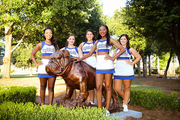 Cheerleaders at bronze bulldog sculpture